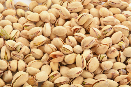 a background of open shelled pistachio nuts from a high angle view