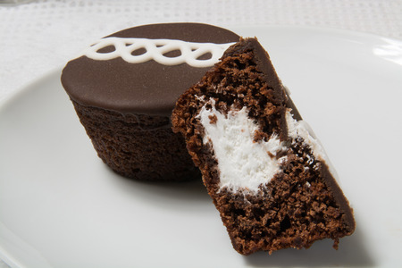 Chocolate cupcakes with a cream filling closeup