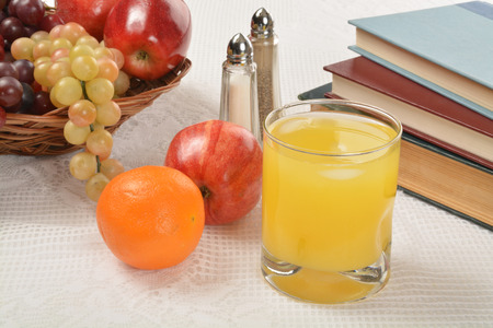 shool: Healthy after school snack of orange juice and fruit near shool books