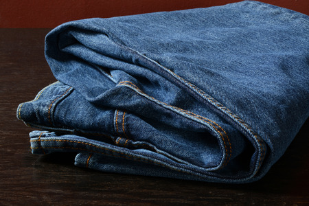 dresser: A pair of folded blue jeans on an old dresser