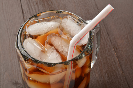 root beer: Close up of a root beer or cola in a mug with a straw