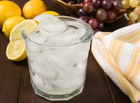 carbonated: A glass of carbonated water with a slice of lemon