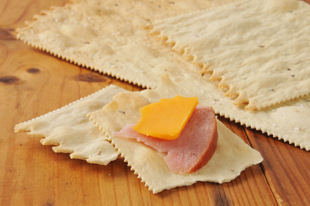 Ham and cheddar cheese on flatbread crackers Stock fotó