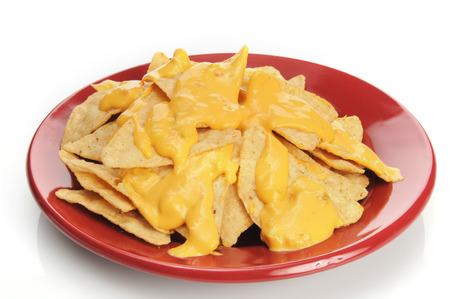 corn tortilla: Corn tortilla chips with cheese sauce on a white background Stock Photo