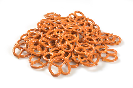A mound of salted pretzels on a white background Stock Photo