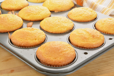 preperation: Yellow cupcakes in a baking tin fresh out of the oven