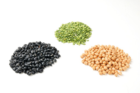 garbanzo bean: Dried black turtle beans, garbanzo beans and split peas on a white background