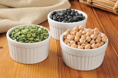 turtle bean: Small bowls of split peas, black turtle beans and garbanzo beans