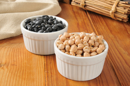 turtle bean: Bowls of dried black turtle beans and garbanzo beans