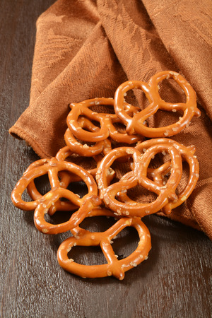 Salted pretzels on a rustic dark wooden table Stock Photo