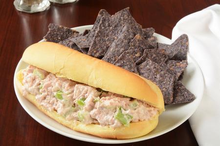 tunafish: A tuna fish sandwich on a hogie bun with organic blue corn tortilla chips