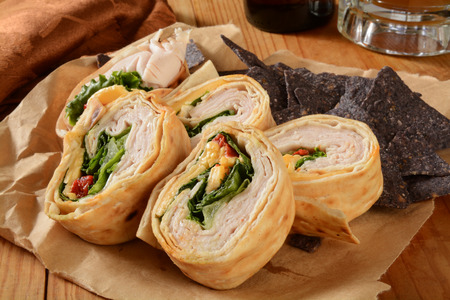corn tortilla: Turkey of chicken wrap sandwich with blue corn tortilla chips Stock Photo