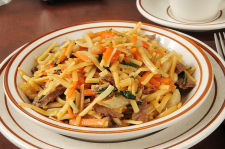 lo mein: Closeup of a bowl of beef lo mein with bok choy