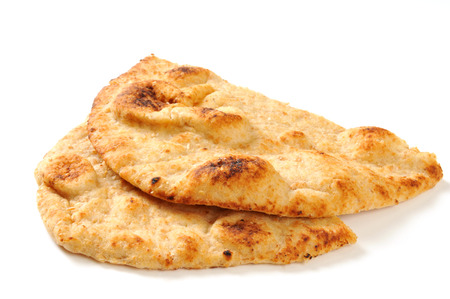 Slices of golden Naan bread on a white background with natural drop shadow