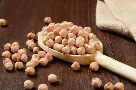 garbanzo bean: A spoonful of dried organic garbanzo beans Stock Photo