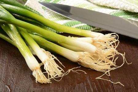 green onions: Freshly washed organic green onions on a cutting board