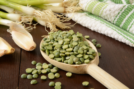 Dried split peas with garlic cloves and green onions photo