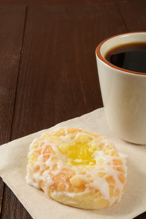 filled roll: Coffe and a lemon cream filled danish roll Stock Photo
