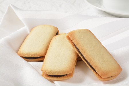 Crispy cookies filled with Belgian chocolate on a white napkin