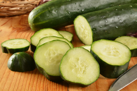 Fresh sliced organic cucumber on a rustic wooden table
