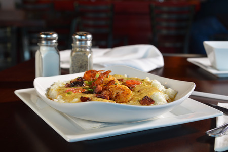 creole: Sauteed shrimp prawns with creole butter sauce, peppers, and vegetable medley on creamy grits