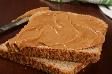 sprouted: Peanut butter on whole wheat sprouted bread Stock Photo