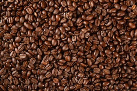 Dark roasted coffee beans from an overhead angle Stock fotó
