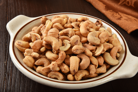 A bowl of roasted salted cashews from a high angle view