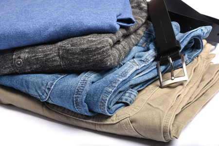 shit: Folded jeans, shirts and sweaters with a belt