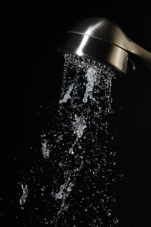 pulsating: Freeze motion photo of a massaging shower head