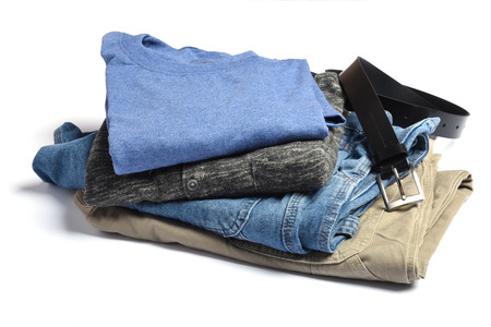 khaki pants: Jeans, pants, sweaters and t-shits with a belt folded on a white table