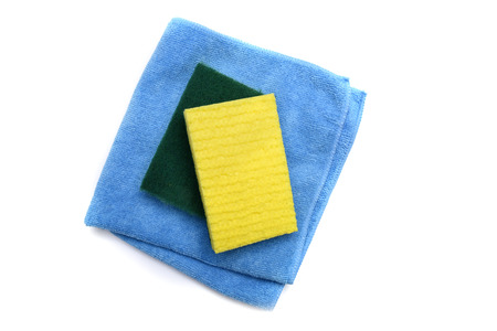 A microfiber cloth and scrubbing sponges from an overhead view