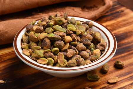 A small bowl of shelled pistachio nuts