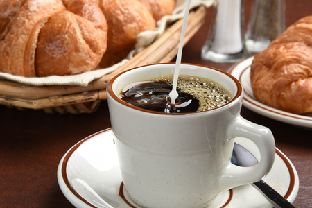 creamer: Pouring coffee creamer into a cup, high speed freeze motion photography