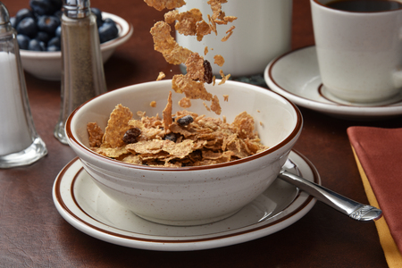 freeze dried: High speed freeze motion photography of pouring bran flakes into a bowl