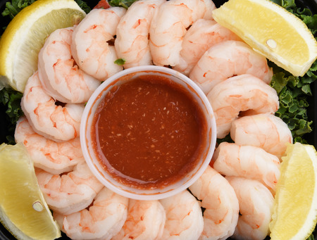 Overhead view of shrimp prawns with cocktail sauce