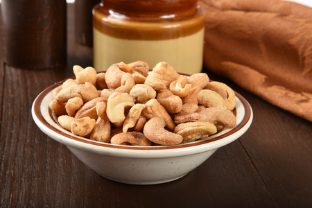 cashews: A bowl of gourmet roasted salted cashews Stock Photo