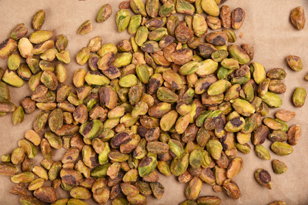 Overhead view of pistachios on brown kraft paper