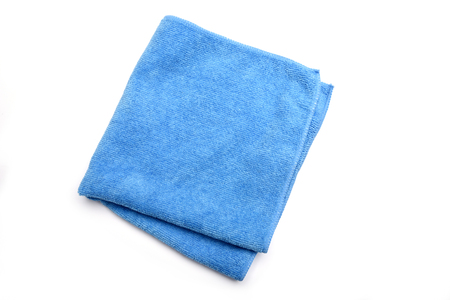 Folded blue microfiber cleaning cloth on a white background Stock fotó