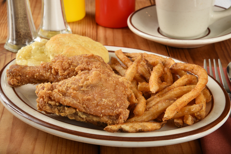 fried chicken: Fried chicken dinner with a biscuit and french fries