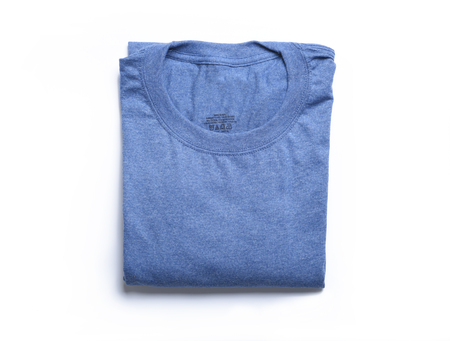 A folded blue t-shirt from a high angle view