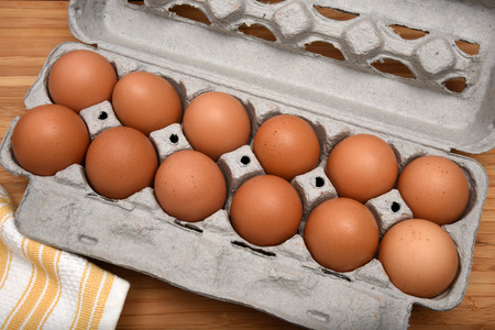 overhead view: A carton of natural, organic brown eggs from an overhead view Stock Photo
