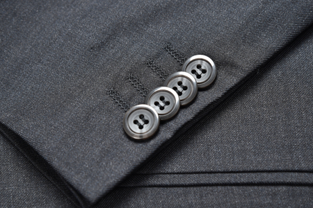 suit  cuff: A row of buttons of the cuff of a men�s suit