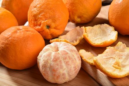 Fresh organic oranges, with one of them peeled
