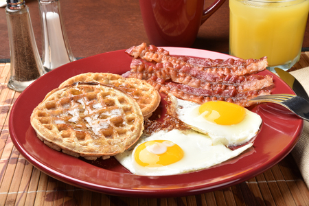multi grain: Breakfast of bacon and fried eggs with multi grain waffles
