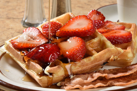 maple syrup: Pouring maple syrup onto Belgian Waffles