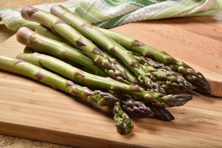 Fresh washed asparagus on a cutting board