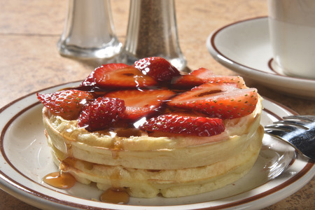maple syrup: Hot buttered waffles with strawberries and maple syrup Stock Photo