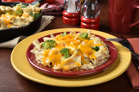 Tuna noodle casserole served in a cast iron skillet Imagens