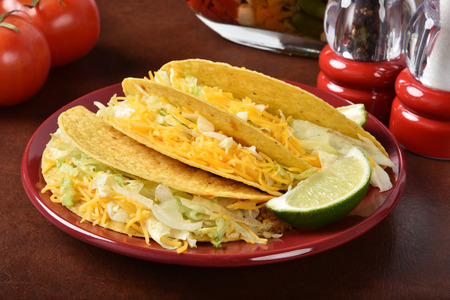 A plate of fresh homemade tacos with cheddar cheese Stock Photo